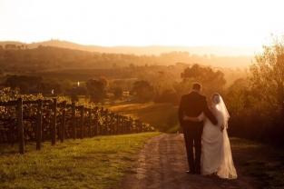 Bride and Groom at sunset with the beautiful views from Immerse Winery Yarra Valley